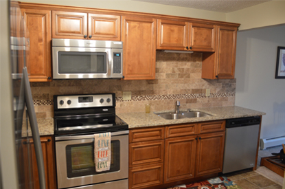 Elegant walnut kitchen cabinets from gec cabinet depot for Best thing to line kitchen cabinets